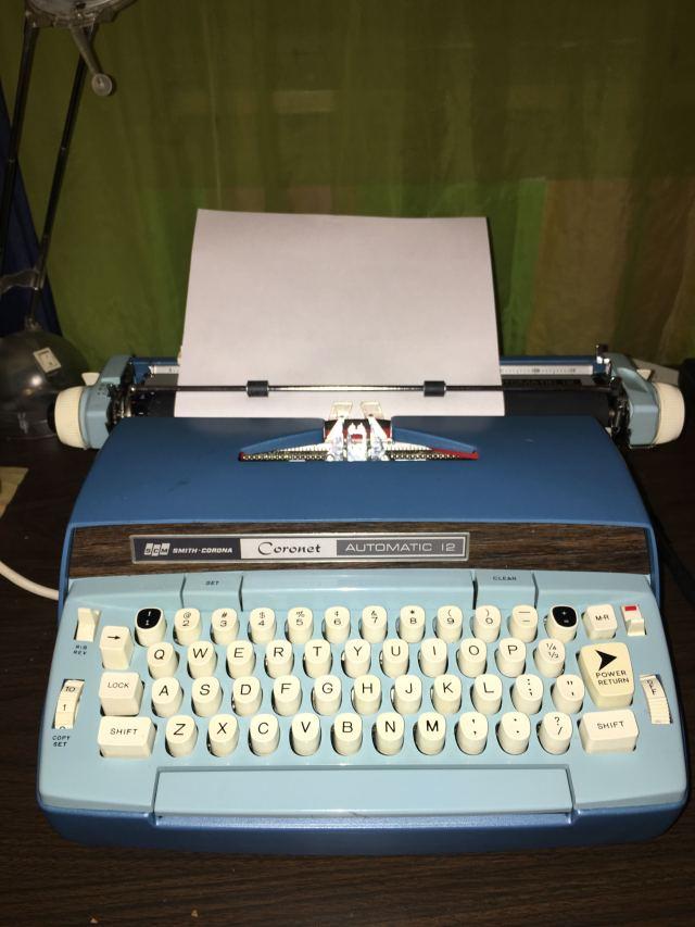 an electric typewriter on a desktop